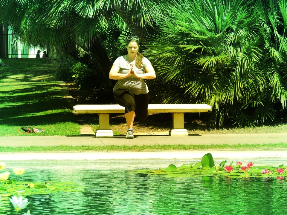 One legged squats in front of a Lily pad pond, not a blaring gym TV